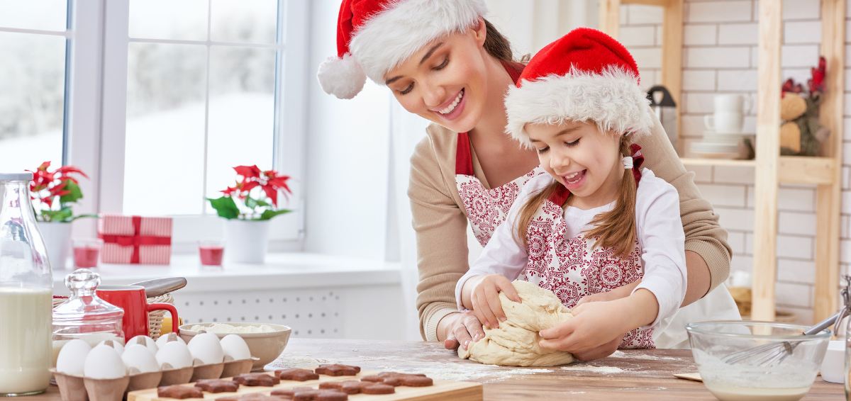 A mother and daughter bake at the holidays.